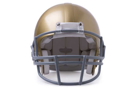 A gold football helmet in front view isolated on a white background