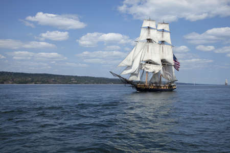 A tall ship known as a brigantine sails on blue water Stock Photo - 18235859