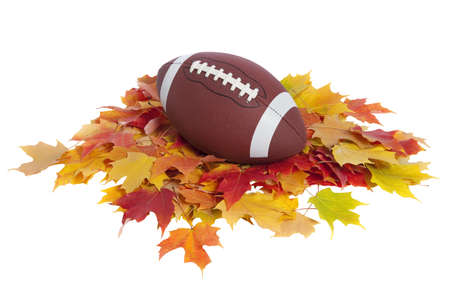 College football on colored maple leaves isolated on white  Stock Photo - 18263326