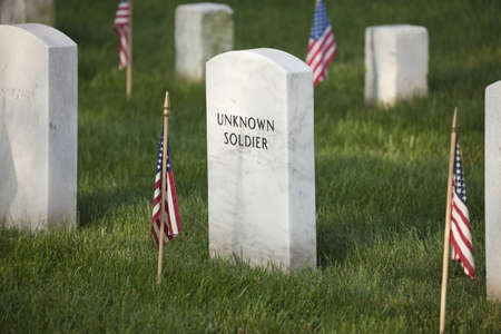 military cemetery: Gravestone of an unknown soldier in Arlington National Cemetery on Memorial Day Stock Photo
