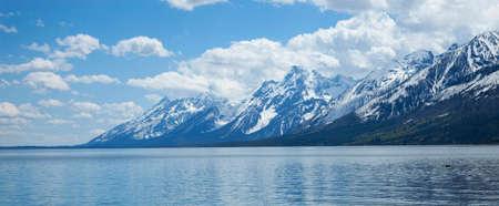 snowcapped: Snowcapped Grand Teton mountain range viewed above Lewis Lake Stock Photo