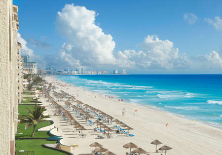 cancun: A view along the beach of the Caribbean Sea and hotels in Cancun, Mexico