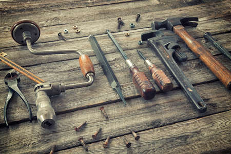 wood cutter: Old antique tools on a rough wood surface Stock Photo