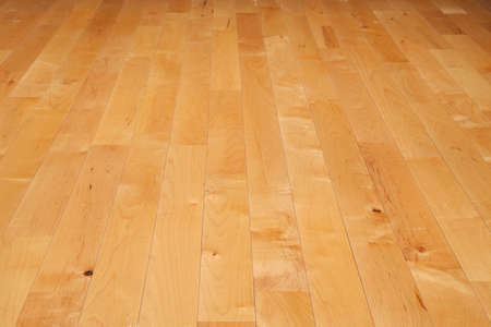 A basketball court floor made of maple hardwood viewed at a low angle Stock Photo