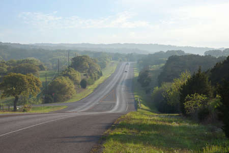 A road in the Texas Hill Country near sundown during spring