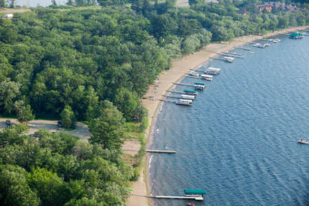 lakeshore: Aerial view of typical lakeshore with docks and boats in Minnesota Stock Photo