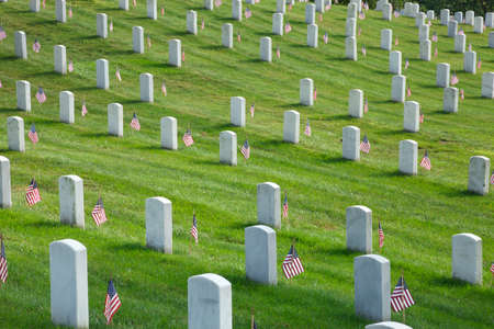 Rows of tombstones with American flags at Arlington National Cemetery on Memorial Day