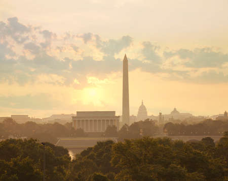 Washington DC skyline with sun and clouds in the morning showing the Lincoln Memorial, the Washington Monument and the Capitol Stock Photo