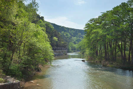 cliffs: The Guadalupe River below cliffs of the Texas Hill Country during Spring Stock Photo