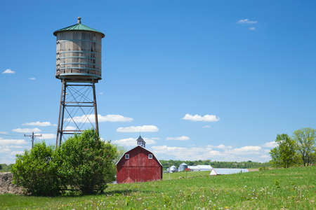 cistern: Old wooden water cistern and red barn in rural Iowa