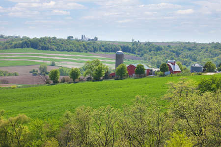 iowa agriculture: Farms on a hillside in the Iowa countryside during spring