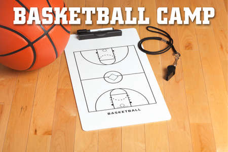 Basketball camp letters on background of a wooden floor with coachs clipboard