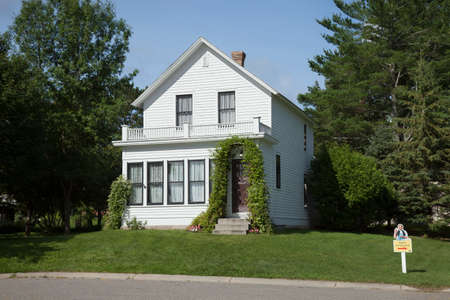 legend: GRAND RAPIDS, MINNESOTA, USA - AUGUST 6, 2016: The birthplace of film legend Judy Garland, star of the Wizard of Oz. Judy lived in this home till she was four years old.
