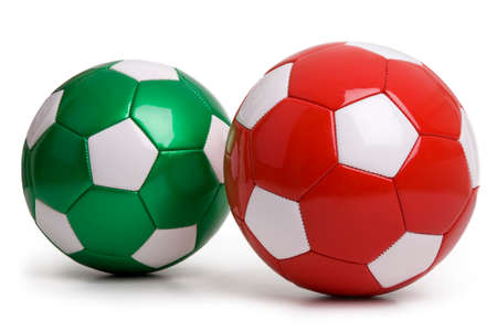 Red and green soccer balls isolated on a white background Archivio Fotografico - 95669226