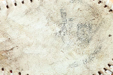 Close up of the grungy leather texture of a used baseball 写真素材