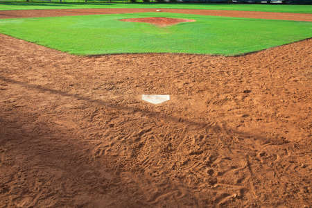 A youth baseball field viewed from behind home plate in morning light Stock fotó