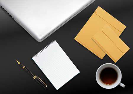 envelops: business desktop with laptop, notepad, envelops and mug of tea Stock Photo