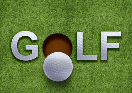 golf green: Golf word on green grass and golf ball on lip of hole Stock Photo
