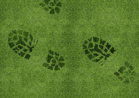 green footprint: Shoe print on green grassland. Stock Photo