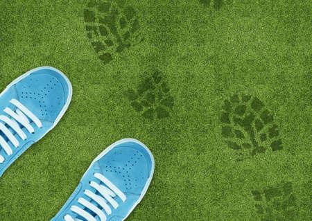 green footprint: Blue Shoe print on green grassland. Stock Photo