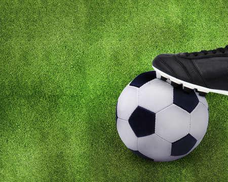 football shoes: Football sport, kid playing soccerand holding soccer ball. Stock Photo