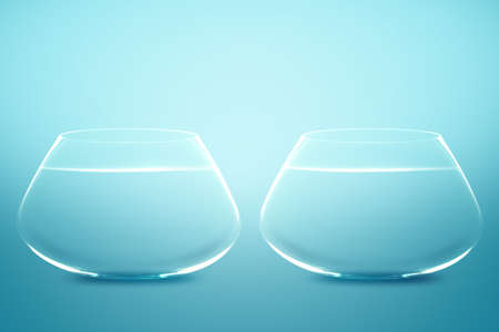 Empty Two fishbowls with water in front of blue background. photo