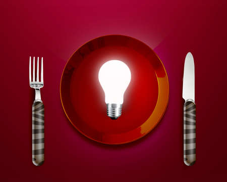 Creative Thinking With Brainstorming, glow lamp in red plate knife and frok. photo