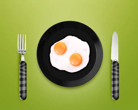 creative egg painting: top view of two fried eggs on black Plate between silver knife and fork on gray background. Stock Photo