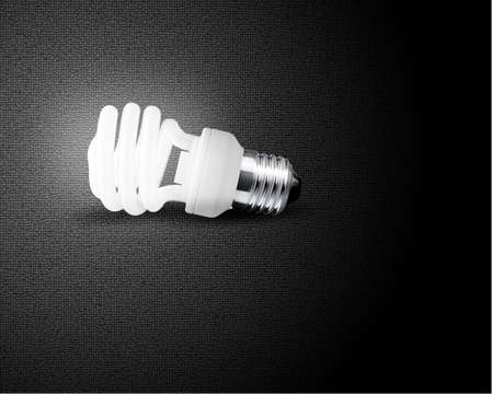 one glowing Light bulb on black background photo