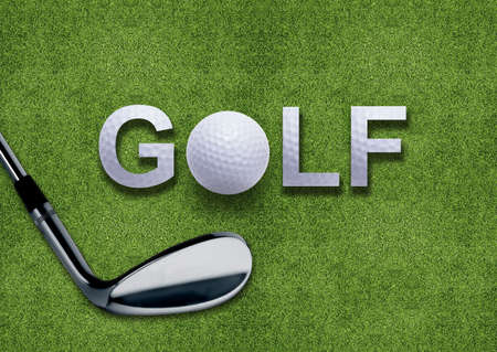 Golf ball and golf word and putter on green grass  photo
