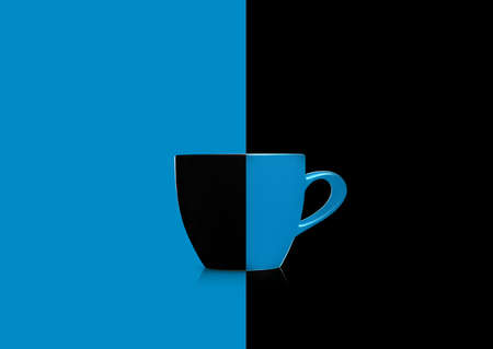 Two colors mug on blue and black background. Stock Photo - 11663757