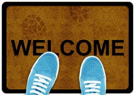 welcome cleaning foot carpet with shoeand shoe print on it. Stock Photo - 11674053