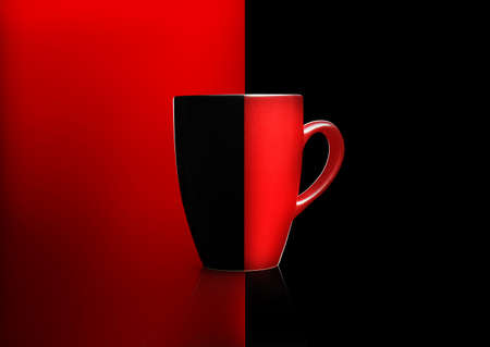 Two colors mug on red and black background,  Stock Photo - 11798689