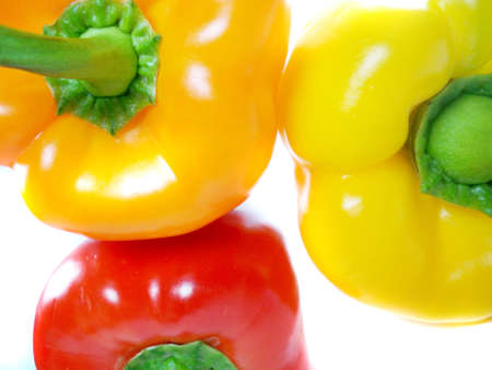 yeloow: three Yeloow, red and orange bell peppers isolated on white background.