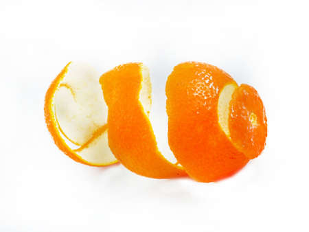 Peel of an orange on white background  photo