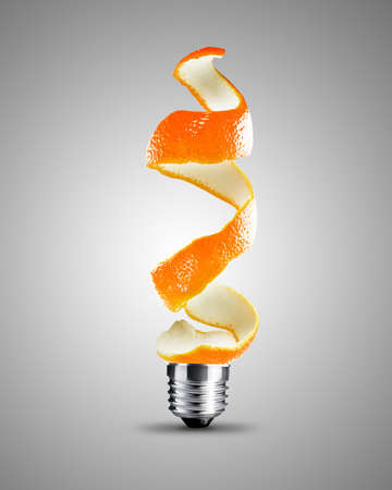 light bulb made from orange peel, light bulb conceptual Image. photo