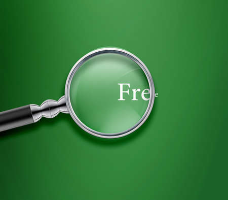 magnified: Magnifying glass with Free word on Green background. Stock Photo