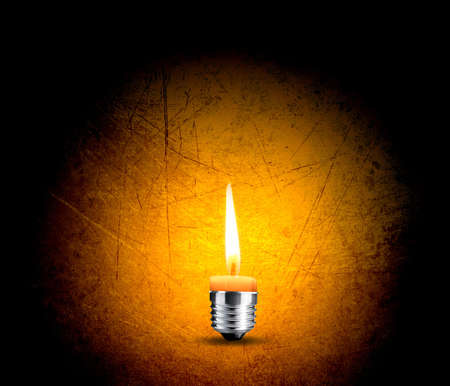 wax candle into lighting bulb, light bulb conceptual Image. photo