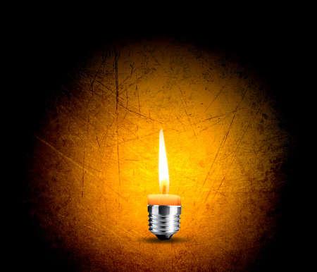 wax candle into lighting bulb, light bulb conceptual Image. photo