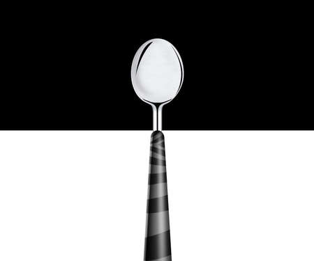 metal spoon on white and black background  photo