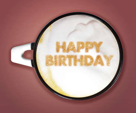 coffee art, A cup of cappuccino with Happy Birthday on Pink background.  photo