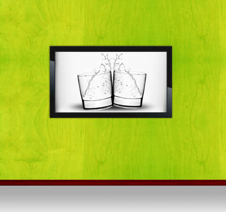 display advertising: Black modern Frame on painting Wall with Two Glasses of water image. Stock Photo