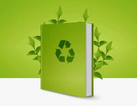 front view of green book with recycle icon and green leaves. photo