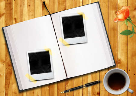 biography:  Biography or curriculum vitae Conceptual image, blank opened book outdoors on wooden disk Pen, blank photo frame and cup of tea.