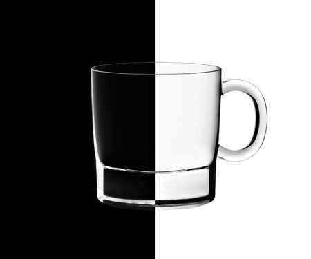 isoliert: Tea glasses in backlight on the black and white contrast background. Stock Photo