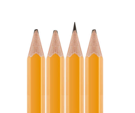 Sharpened pencil flipped in group of broken ones isolated on white background photo