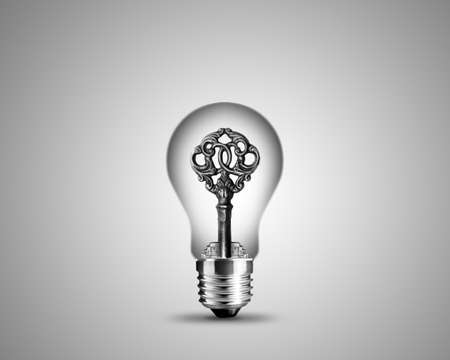 old key in light bulb, conceptual image for solutions. photo