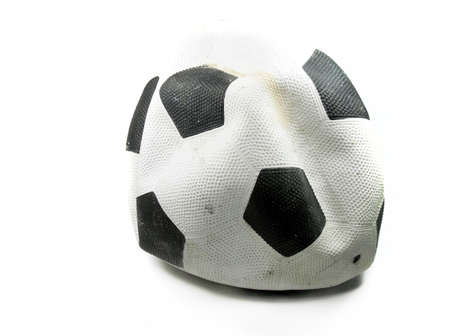 defective: old deflated soccer ball