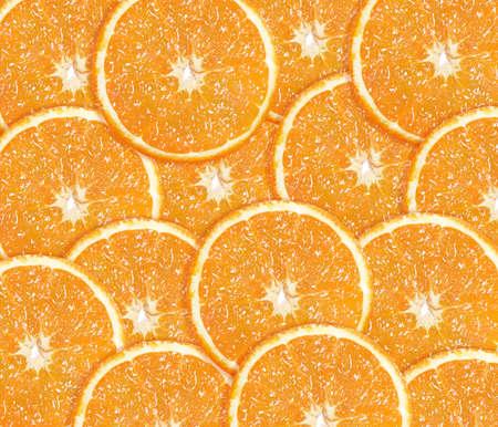 Fresh orange background from slices of orange. photo