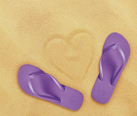 flops: a pair of flip flops on the beach sand, Summer back concept. Stock Photo